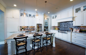 Bellmoore Park features luxury kitchen options with a large island overlooking the living area.