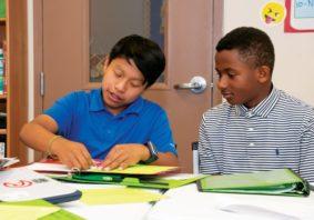 Two boys working on classwork