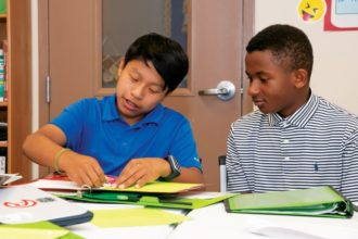 Two boys working on classwork
