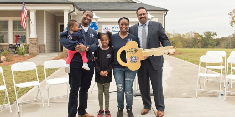 Shreves family with key at new home