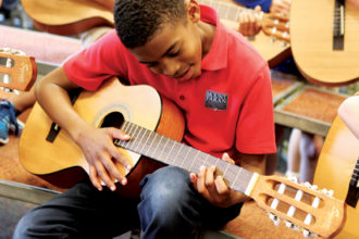 Mt. Paran student playing guitar