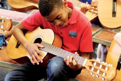 Mt. Paran student playing guitar